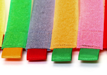 Pack of Colorful Velcro Strips, on white background